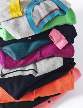 Pile of folded cashmere jumpers
